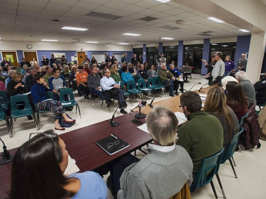 Linda and Bill Donovan, far right, owners of the Lucky Spot convenience store in Richmond, speak during a community meeting they organized to discuss opiate addiction and its consequences on Wednesday in Richmond.