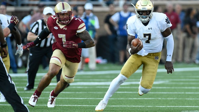 Sep 16, 2017; Chestnut Hill, MA, USA; Notre Dame Fighting Irish quarterback Brandon Wimbush (7) runs with the ball while Boston College Eagles defensive end Harold Landry (7) gives chase during the first half at Alumni Stadium. Mandatory Credit: Bob DeChiara-USA TODAY Sports