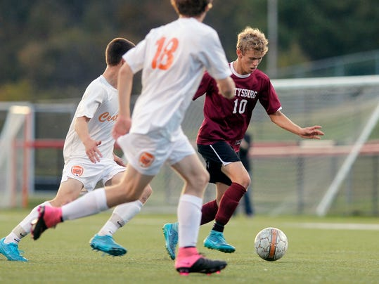 Gettysburg's Adam Yingling drives against Central York's Carter Luckenbaugh (2) and Nicholas Starr (18) in the first half of Thursday's YAIAA boys' soccer championship. Yingling scored the game's lone goal in Gettysburg's 1-0 win. (Chris Dunn - GameTimePA.com)