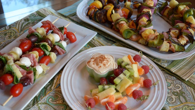 Antipasto on a stick, grilled chicken and grilled veggie kebabs and fruit kebabs with dip honor the season of festivals and fairs.