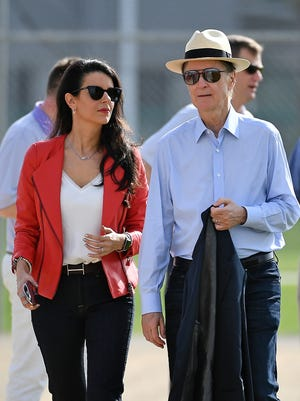 Boston Red Sox owner John Henry (R) and his wife and co-owner Linda Pizzuti Henry (L) walk to the practice fields during a spring training workout at Jet Blue Park at Fenway South on Feb. 18, 2019.