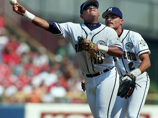 Brewers second baseman Ron Belliard throws to first