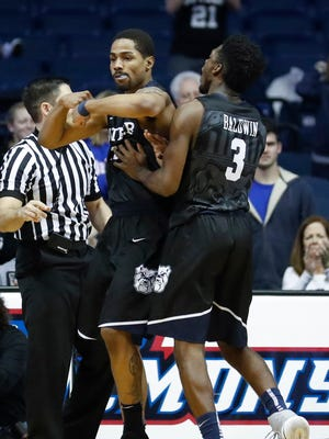 Jan 21, 2017; Rosemont, IL, USA; Butler Bulldogs guard Kethan Savage (11) celebrates after scoring with guard Kamar Baldwin (3) against DePaul during the overtime at Allstate Arena. Mandatory Credit: Kamil Krzaczynski-USA TODAY Sports