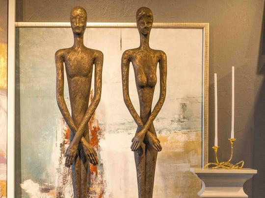 These two tall bronze people statues are actually made