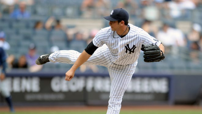 New York Yankees' Luis Cessa delivers the ball to the Tampa Bay Rays during the seventh inning of a baseball game against the Tampa Bay Rays Sunday, Aug.14, 2016, at Yankee Stadium in New York.