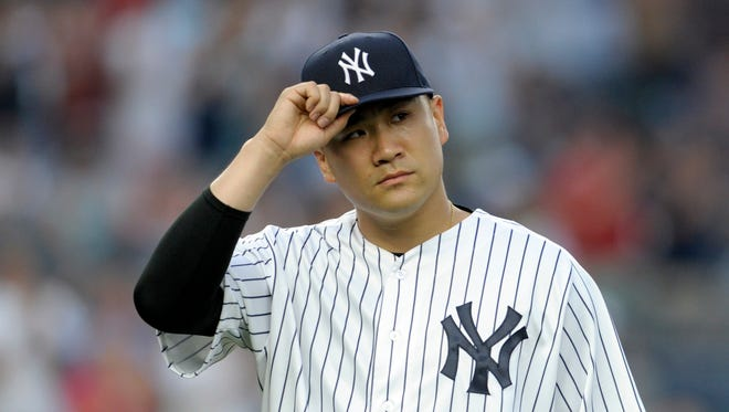 New York Yankees pitcher Masahiro Tanaka acknowledges fans as he leaves a baseball game during the eighth inning against the Tampa Bay Rays, Saturday, Sept. 10, 2016, at Yankee Stadium in New York.
