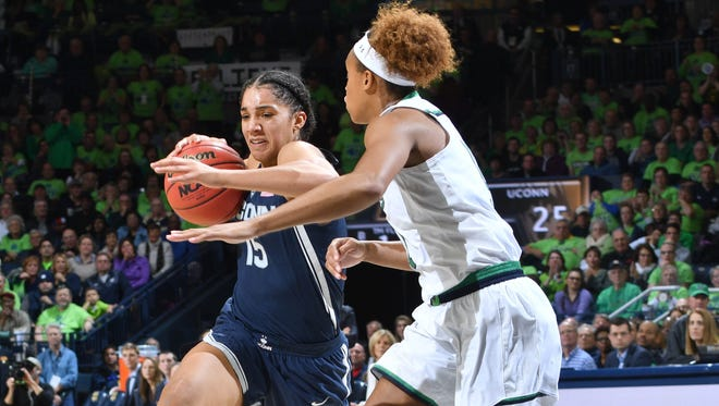 Connecticut Huskies forward Gabby Williams (15) dribbles as Notre Dame Fighting Irish forward Brianna Turner (11) defends in the second quarter at the Purcell Pavilion.
