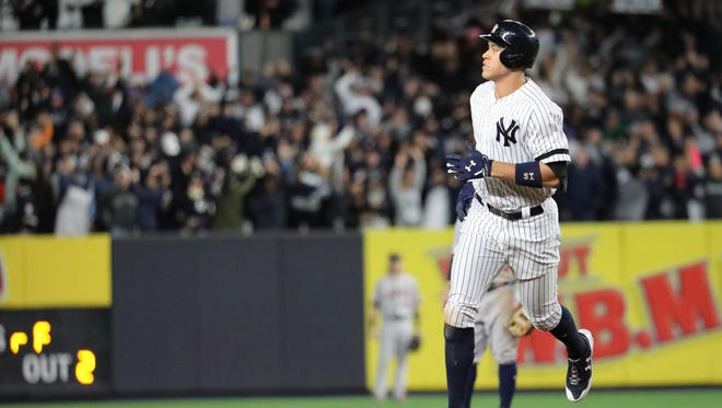 Aaron Judge rounds the bases after his three-run home run  in the fourth inning of Game 3, Monday, October 16, 2017.