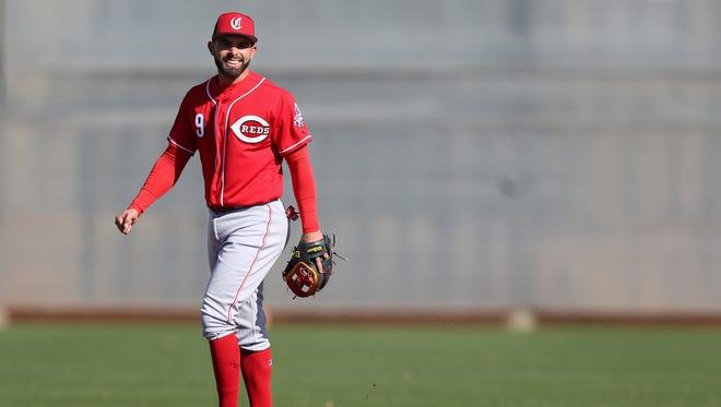 Cincinnati Reds second baseman Jose Peraza (9) smiles during fielding drills, Tuesday, Feb. 20, 2018, at the Cincinnati Reds Spring Training facility in Goodyear, Arizona.