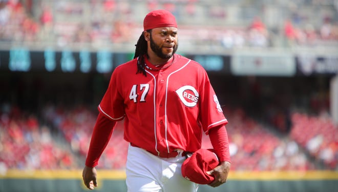 Reds pitcher Johnny Cueto walks off the field during his 20th win of the season.