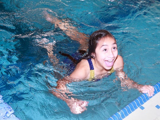 Annalysia Ortiz, 11, of Albuquerque, finishes the 25-meter breaststroke race during Special Olympics New Mexico's Four Corners Invitational on Saturday at the Farmington Aquatic Center.