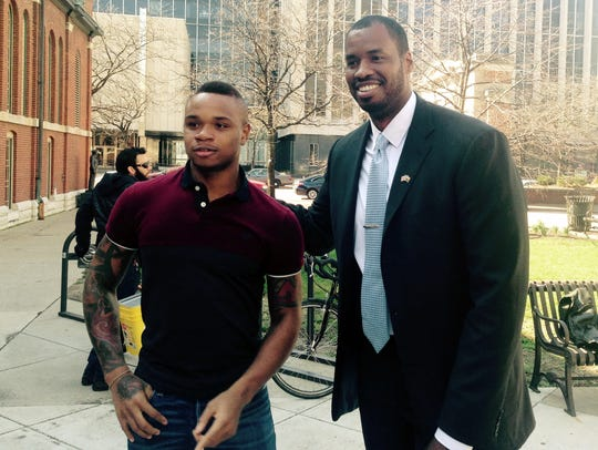 Derrick Gordon, left, the first openly gay Division