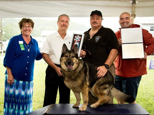 From left, Vicki Kubic, Tioga County Kennel Club; Assistant Chief Craig Williams, Endicott Police Department; Endicott Officer John Vanek; state Sen. Fred Akshar; and canine Tarah.