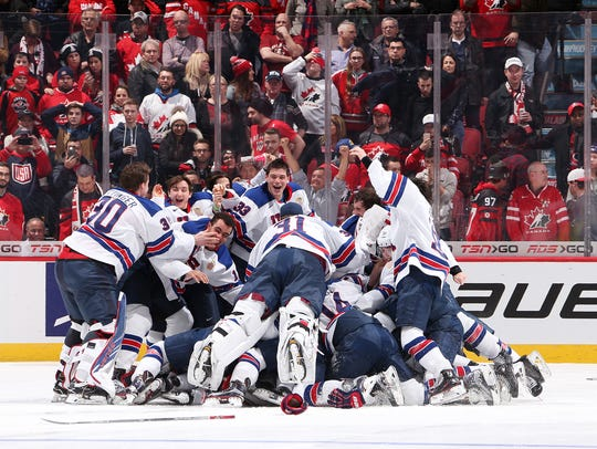 USA players celebrate after a 5-4 shoot-out win over