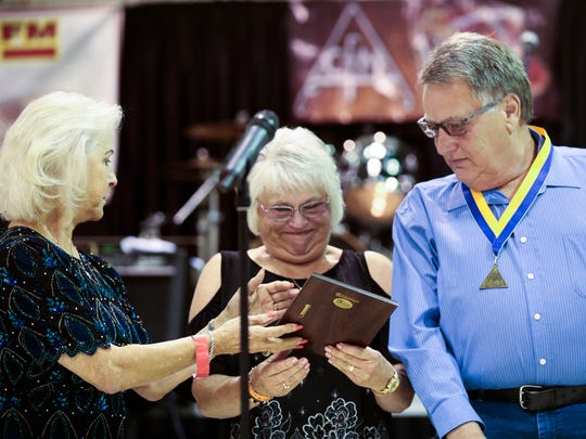 La Poussiere Dance Hall owners Judith and Lawrence Patin accept their plaque and invocation into the Cajun Music Hall of Fame during the 29th Annual Le Cajun Awards Ceremony in Rayne Friday, August 18, 2017.
