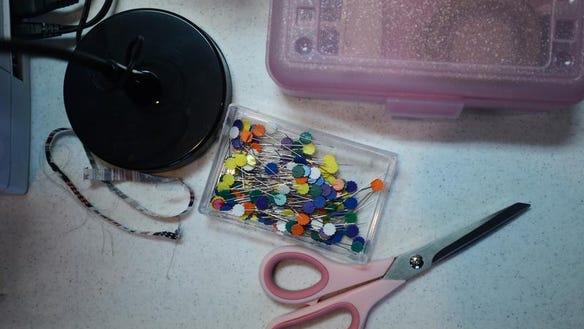 Scissors, pins and fabric scraps.