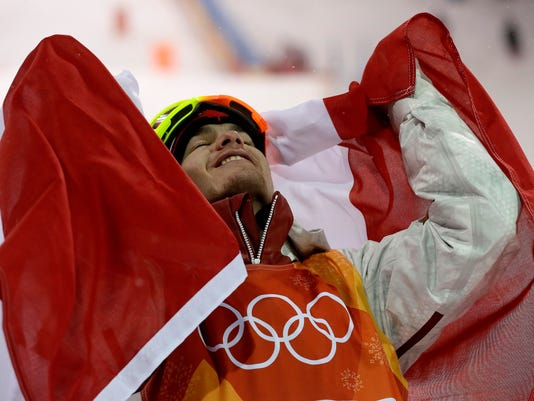 Gold medal winner MikaelKingsbury, of Canada, celebrates after the men's moguls qualifying at Phoenix Snow Park at the 2018 Winter Olympics in Pyeongchang, South Korea, Monday, Feb. 12, 2018. (AP Photo/Kin Cheung)