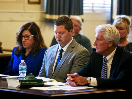Ray Tensing reacts to watching his body camera footage on the first day of Tensing's retrial in Hamilton County Common Pleas Judge Leslie Ghiz's courtroom Thursday, June 8, 2017.   Tensing, the former University of Cincinnati police officer, is charged with murder in the death of Sam DuBose, during a routine traffic stop on July 19, 2015. Tensing's lawyer, Stew Mathews, has said Tensing fired a single shot.