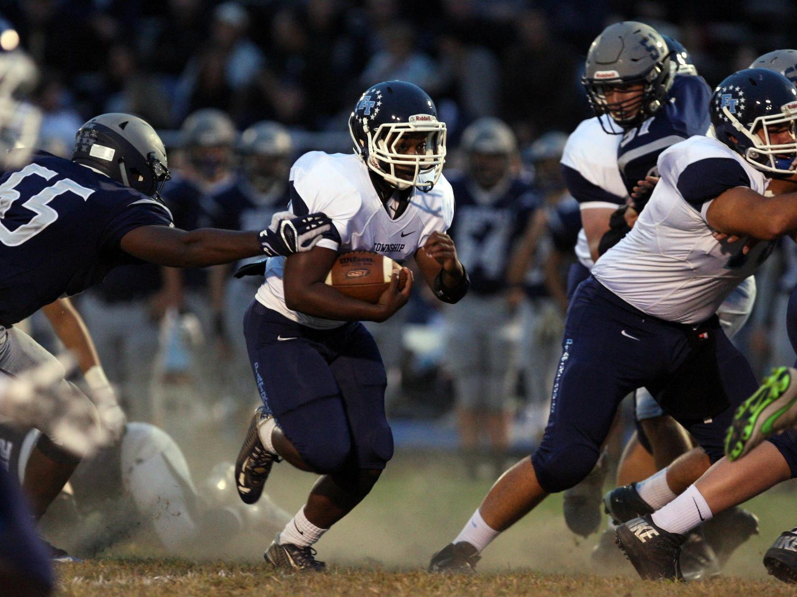 Rychard Hanshaw, #22 Freehold Township, carries the ball against Howell in a football game Friday, September 25, 2015, at Howell High School.