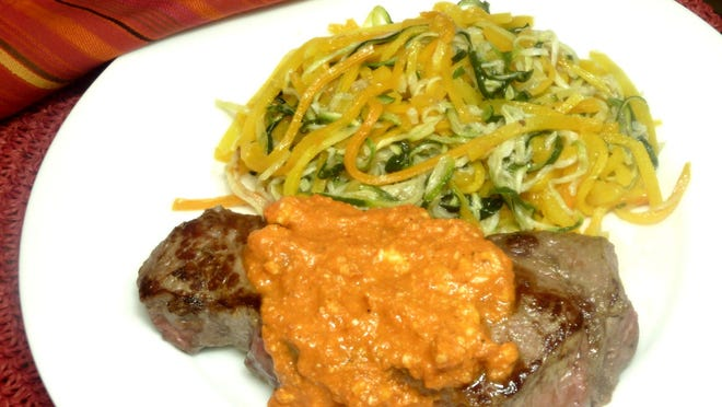 Strip Steak with Romesco Sauce and Spiral Zucchini and Butternut Squash.