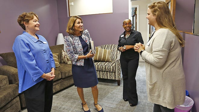 From left, Sue Chandler, executive director of DOVE, Lt. Governor Karyn Polito and DOVE advocates Julie Thermidor and Jill Zaricor in the DOVE offices in Quincy last year.