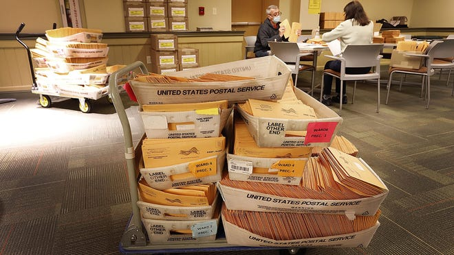 Quincy election officials work to prepare 21,000 ballots for mailing to Quincy voters on Tuesday October 6, 2020. Greg Derr/ The Patriot Ledger