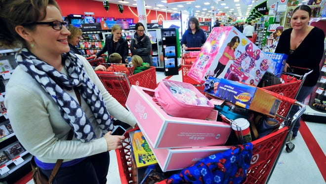 Donna Rhodes, left, Waynesboro, and her sister Krista Moelter, Philadelphia, shop for toys Friday at  Target, Chambersburg Crossing. Moelter said she enjoyed the relaxed shopping experience in Chamberburg over the huge crowds around Philadelphia stores on Black Friday.