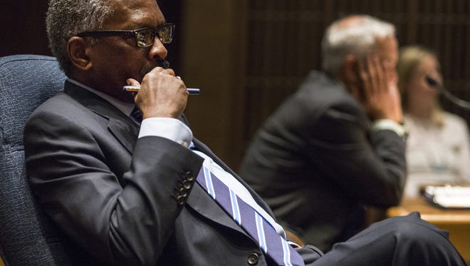 County Councilman Penrose Hollins listens to speakers during a County Council meeting on in 2015.