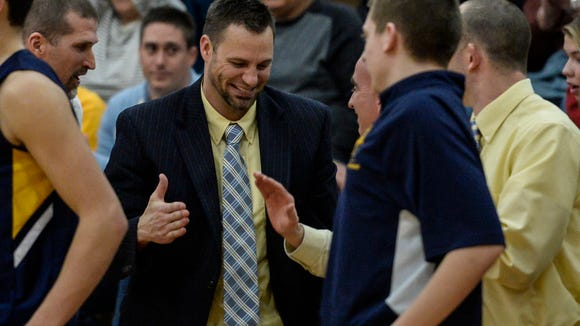 Elco head coach Brad Connors celebrates after the Raiders' 63-52 win over Berks Catholic on Monday at Warwick. Elco clinched its first-ever state tournament berth with the victory.