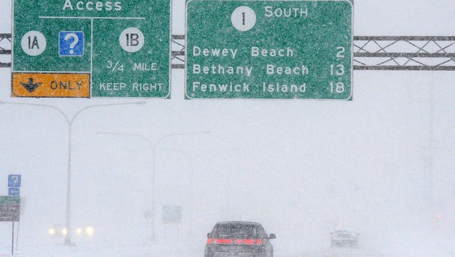 Low visibility caused by windy conditions has made travel difficult on Coastal Highway as snow continues to fall in the Rehoboth Beach area with plows and snow removers trying to keep up. The boardwalk is getting covered by drifting snow as some brave souls did venture out to see it.