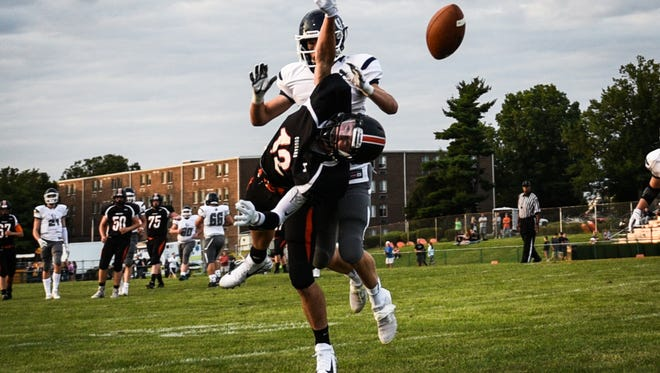 Palmyra's Kyle Wasilewski (lunging) and his Cougar teammates host Middletown in a Homecoming battle of 5-0 teams on Friday night..