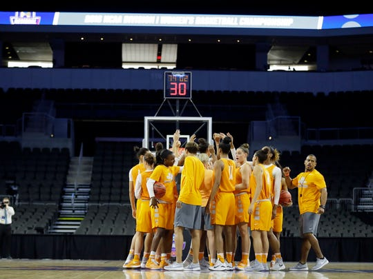 Tennessee players huddle on the court during practice ahead of a regional semifinal women's college basketball game in the NCAA Tournament on Thursday.