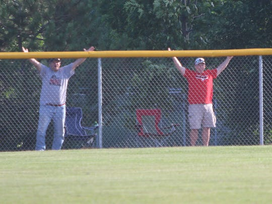 A pair of fans of Nicolet and Homestead question a call in the sixth inning of a sectional final between Germantown and Menomonee Falls on Monday.