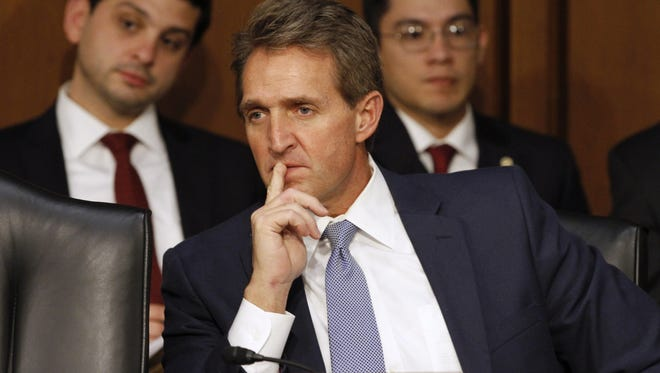Sen. Jeff Flake, R-Ariz., has introduced legislation that would force the Department of Veterans Affairs to fire employees with felony convictions.