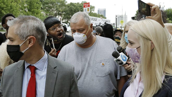 Ohio House Speaker Larry Householder walks out of U.S. District Court.