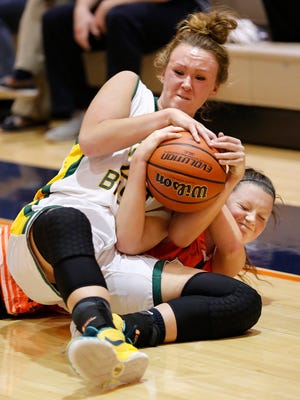 Benton Central's Katie Shields and Harrison's Rachael Lehman fall to the floor as they battle for a loose ball Tuesday, November 17, 2015, in the girls J&C Hoops Classic at Harrison High School. Benton Central beat Harrison 69-39.