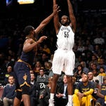 Brooklyn Nets forward Earl Clark shoots a three pointer over Cleveland Cavaliers center Tristan Thompson (13) in the second half of an NBA basketball game on Friday, March 27, 2015, in New York. The Nets won 106-98.