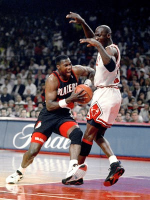 FILE - In this June 14, 1992, file photo, Chicago Bulls' Michael Jordan, right, tries to hold off Portland Trail Blazers' Jerome Kersey during Game 6 in basketball's NBA Finals in Chicago. Kersey, the small forward who played his first 11 NBA seasons with the Blazers and helped the San Antonio Spurs win the 1999 title, has died. He was 52. The Trail Blazers confirmed Wednesday night, Feb. 18, 2015, that Kersey had died, but didn't provide details.