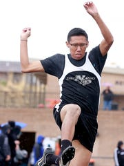 Navajo Prep's DeShane Begay competes in the long jump on Friday at the Penny McKnight Invitational at Fred Cook Memorial Stadium in Aztec.