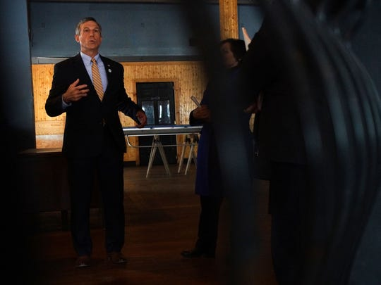 Gov. John Carney speaks inside a 6,000 square foot space at 1 West Lookerman St. that is currently vacant, while touring Loockerman St. for the launch of Unblock the Block, a marketing campaign encouraging business growth in the historic downtown business district.
