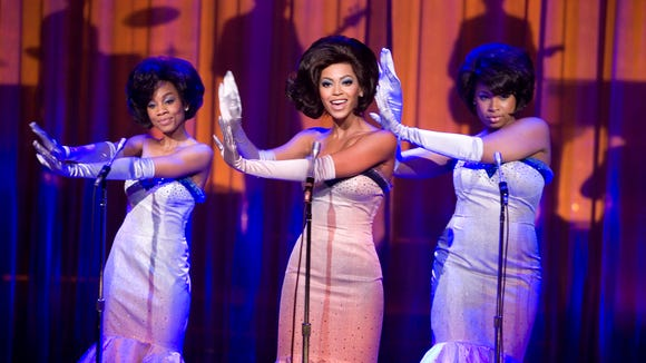 Anika Noni Rose, left, Beyonce Knowles, center, and
