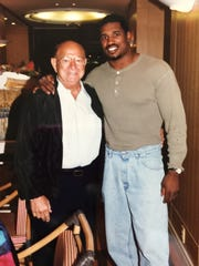 Alonzo Highsmith and famous trainer Angelo Dundee, best known for his work with Muhammad Ali. Dundee trained 15 world champions during his illustrious career.
