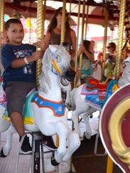 RJ Nehr, 9, of Roseville, rides a merry-go-round at