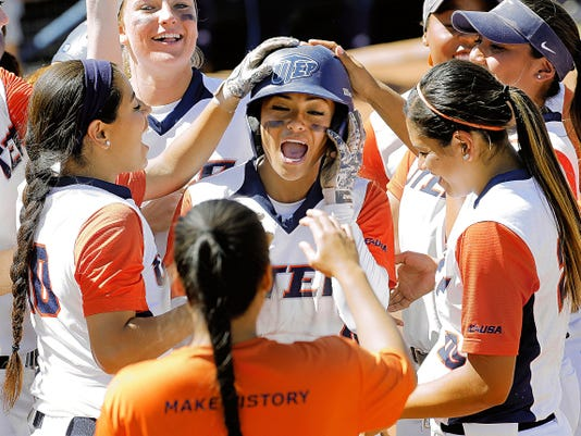 UTEP's Kawehiokalani Netane celebrates after her two-run homer against FIU on Saturday at the Helen of Troy Softball Complex. Netane was named the Conference USA Player of the Week on Monday.