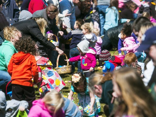 A toddler drops an egg in a basket during a flurry of activity as the group of 2 through 4 year-olds hunt down Easter Eggs during the 8th annual Moul Field Easter Egg Hunt in Hanover on Saturday.