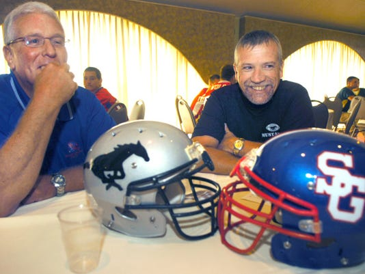 South Western coach Don Seidenstricker, right, spoke with Spring Grove coach Gregg Trone during YAIAA media day at the York Expo Center in 2010.