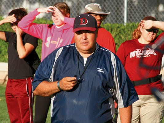 Headlight File Photo   Deming High Head Football Coach Fernie Holguin says there is plenty of work ahead before Friday's clash with visiting Carlsbad High. Kick off is set for 7 p.m. at DHS Memorial Stadium.