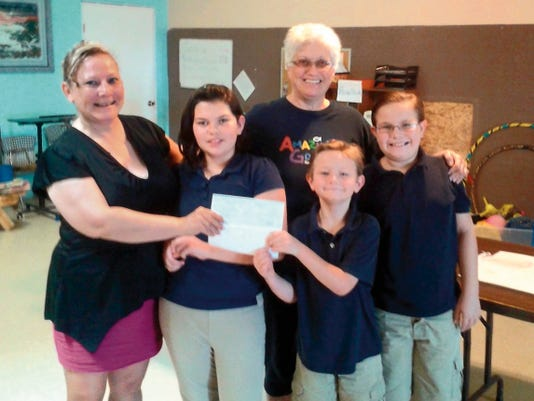 """Lighthouse Christian Academy received a check for 1,000, courtesy of the Deming Elks Lodge 2750. The nonprofit private school in Deming plans to use the donation to purchase new computers. Lighthouse Christian Academy administration says it provides quality education using Christian principles. Elks Gaming Accountant Tammy Zumwalt said, """"This donation fits perfectly with the Elks goals, since all members are required to believe in God, and at the same time, the organization is helping local kids, another of the Elks' goals. The donation was a perfect fit for our organization."""" This donation was made possible with gaming charity money. Pictured in front, from left, are Zumwalt and students Ashlynn Herrera, Everett Zumwalt and Lawrence Zumwalt. In back, from left, are Deborah Kelley of the Academy."""