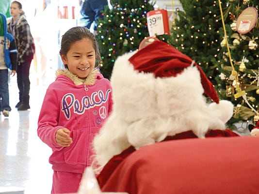 Headlight File Photo   Shop With A Cop committee members are kicking off the fund-raising season that can make Christmas holiday a joyous time for many of Deming and Luna County's children.