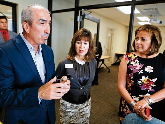 Randy Pacheco, dean of the San Juan College School of Energy, speaks to Barbara Damron, New Mexico Higher Education Department cabinet secretary, and Gov. Susana Martinez Tuesday during a tour of the new School of Energy on the SJC campus in Farmington.